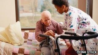 Nurse helping elderly man to stand