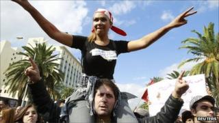 People chant slogans during a demonstration against hardline Islamists in Tunis on 16 October