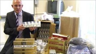 Mark Hughes, Trading Standards Manager at Nottinghamshire County Council with the seized cigarettes