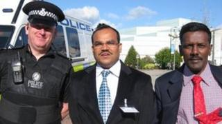 Two Indian police officers at the University of Warwick with Sgt Paul Mercer