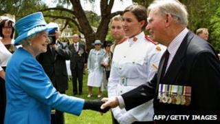"""Britain""""s Queen Elizabeth II (L) meets with Arthur """"Bushy"""" Pembroke (R) and his granddaughter, Staff Cadet Harriet Pembroke (2nd R), after presiding over the """"Presentation of the Colours"""" to the Royal Military College, Duntroon in Canberra"""