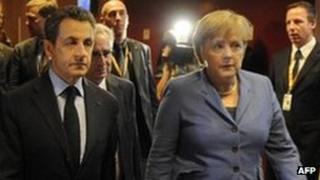 French President Nicolas Sarkozy (left) and German Chancellor Angela Merkel in Brussels - 23 October 2011