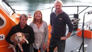 Nigel and Karen Large with their dog Ben and the St Helier lifeboat coxswain