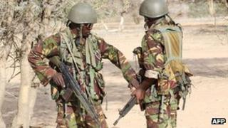 Kenyan soldiers talk as they prepare to advance near Liboi in Somalia, on 19 October 2011