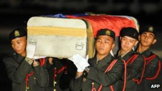Philippine military personnel carry the coffin of a soldier killed in a rebel ambush on October 19th