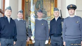 Former 201 Squadron members with standard. From left to right; Master Aircrewman Keith Treece, Sgt Simon Bliault, Flt Lt Dave Irvine, Flt Sgt Justin Morris and Sqn Ldr Andy Holden