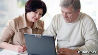 Two people using a computer