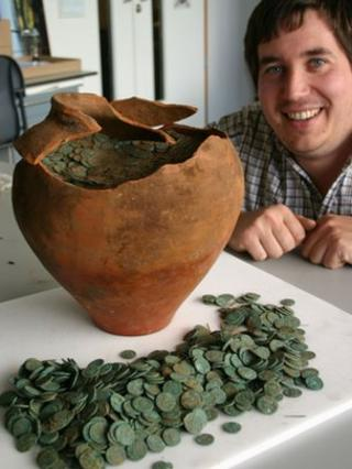Peter Reavill with the hoard of Roman coins