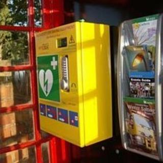 Telephone box with defibrillator