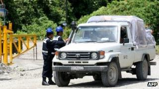 Freeport McMoran security guards inspect an employee's vehicle leaving the Freeport McMoran administrative compound in Timika, Indonesia's Papua province, on Wednesday