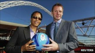 GB women's football coach Hope Powell (L) and men's coach Stuart Pearce at Wembley Stadium, 20 October 2011