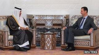 "Syria's President Bashar al-Assad (R) meets with Qatar""s Prime Minister Sheikh Hamad bin Jassim Bin Jabr Al-Thani (L) in Damascus October 26, 2011"