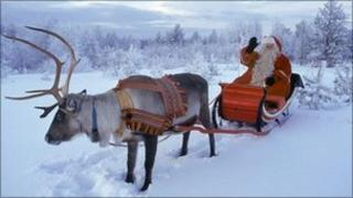 Father Christmas and reindeer in Lapland