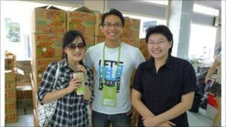 Rungsun Munkong and two volunteers at the flood relief centre in Bangkok