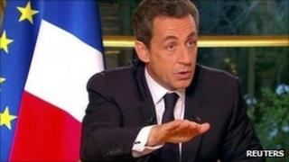 France's Nicolas Sarkozy speaks to journalists, 27 October