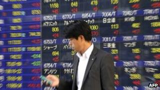 Investor besides a market data board