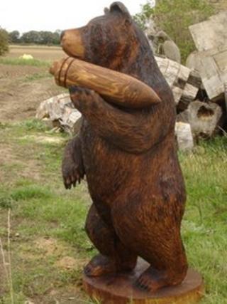 Carved mascot of the bear cub 'Wojtek'