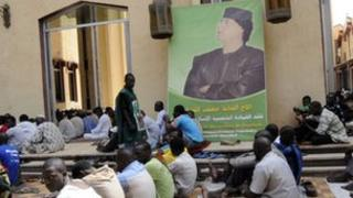 A portrait of Col Gaddafi at a mosque in Mali