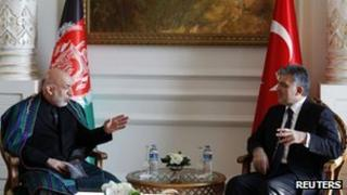 Turkey's President Abdullah Gul (R) meets with his Afghan counterpart Hamid Karzai in Istanbul November 1, 2011.