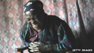 Laughing Kenyan woman