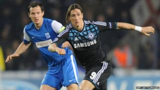 Genk's Daniel Tozser (left) vies with Chelsea's Fernando Torres (right) during the UEFA Champions League Group E match between Krc Genk and Chelsea