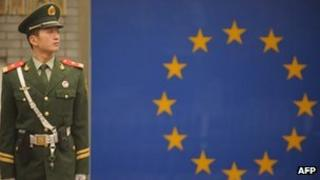 A Chinese paramilitary policeman stands guard outside the European Union Delegation in Beijing on 1 November 2011