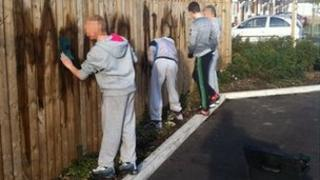 Teenagers cleaning graffiti. Photo: Cleveland Police