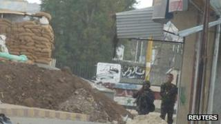 Syrian soldiers are seen at an army checkpoint in Hula near Homs October 19, 2011.