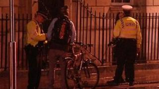 Police officers speaking to cyclists in Oxford