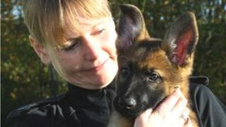 Handler PC Lynn Law with Kate the German shepherd puppy