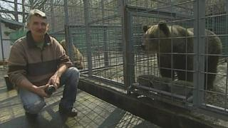 Pavel Pasko and rescued bear Uske