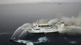 Ferry being hosed down after catching ablaze in the Gulf of Aqaba, 3 November 2011