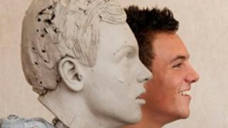 Tom Daley with his waxwork which is being constructed