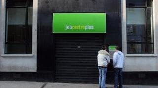 Two people outside a Job Centre Plus