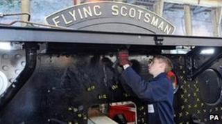 Apprentice engineer Andy Christie carries out work on the chassis of the Flying Scotsman