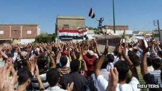 Demonstrators in Hula, near Homs in an undated picture released Friday