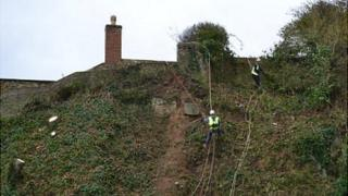 Work begins to repair a land slip on a Guernsey cliff path