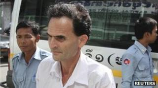 James D'Agostino arrives for the hearing of his verdict at the Phnom Penh Municipal Court 4 November 2011