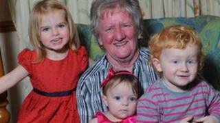 Hallie-May, Caden, and Bella-Lee with their great-grandmother Pat Rogers