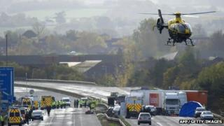 A police helicopter takes off from an area on the M5 motorway near Taunton in Somerset where an accident occurred on 5 November 5 2011