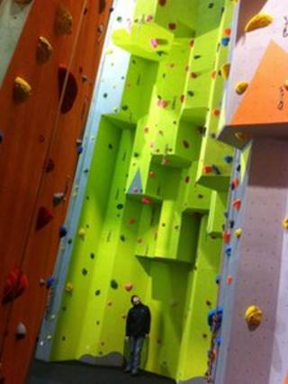 Lesley Gwyer shows the scale of the new climbing wall