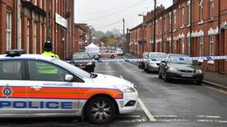 Police cordon seals the area around Linden Street in Leicester after a body of a man was found in the street