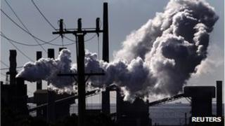 Vapour rise from a steel mill chimney in the industrial town of Port Kembla, south of Sydney. File photo