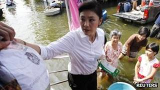 Thai PM Yingluck Shinawatra helps deliver relief supplies to Bangkok residents on 7 November 2011