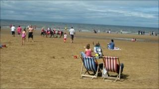 Blackpool beach showing holidaymakers