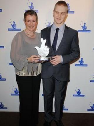 Mairi Morrison and Matthew Ward from Sense Scotland collecting National Lottery Award