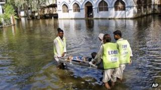 Pakistani medics in flood water in Sindh province, October 2011