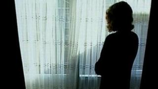 Generic woman standing at a window