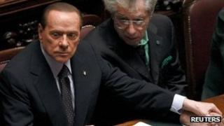 Silvio Berlusconi and Northern League leader Umberto Bossi in parliament - 8 November