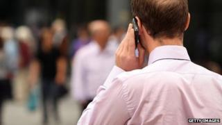 A businessman uses his smartphone